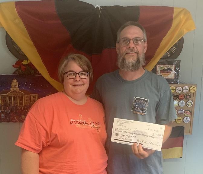 2021 Half-Pot Winner Steve Brenner (with his wife Dana)